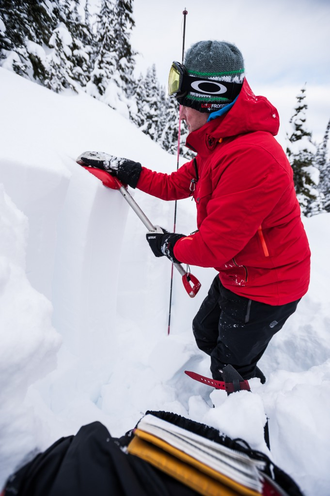 Mitigating risk. One of Last Frontier Helsikiing's guides does his daily snowpack analysis.  Photo - Dave Silver