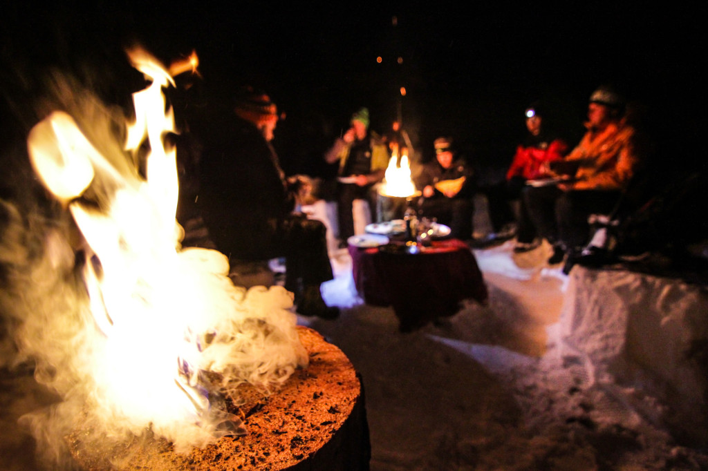 Always nice to have a cozy puffy jacket by the fire with a cup of mulled wine.  Photo - Caton Garvie